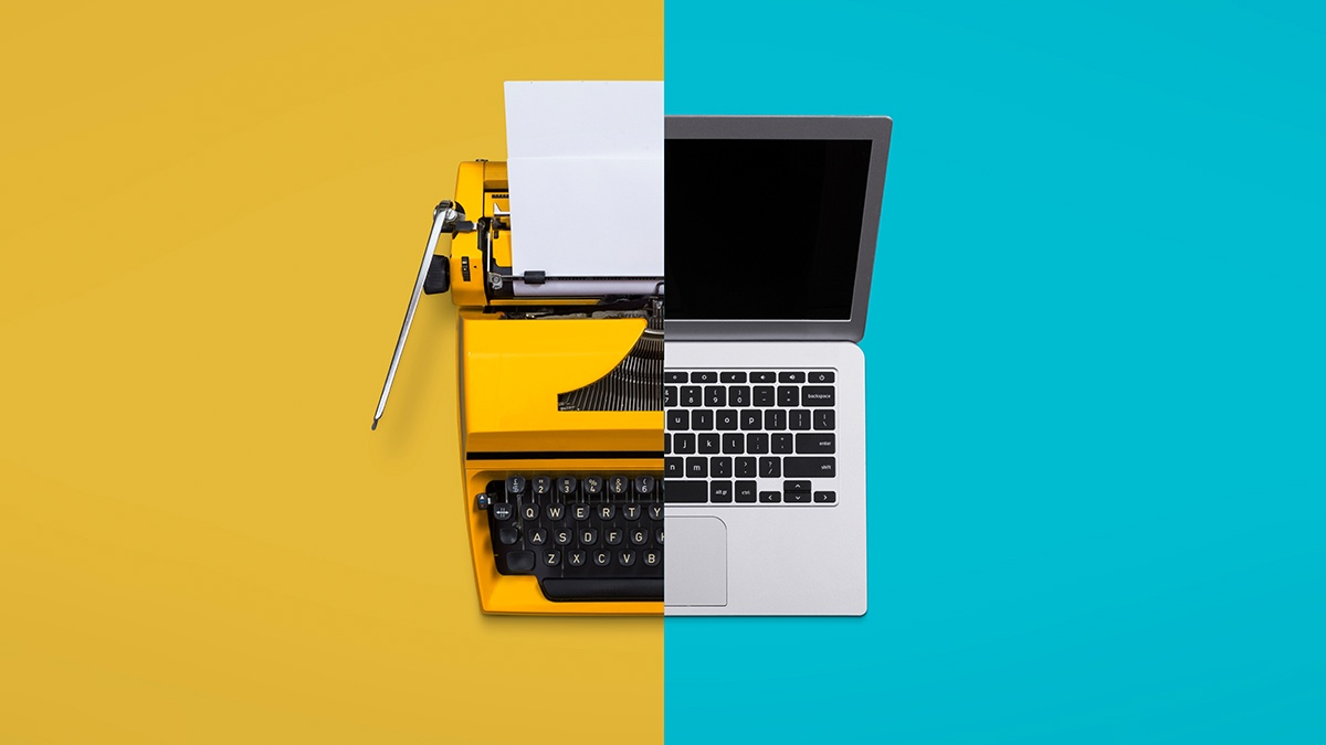 a typewriter and a laptop